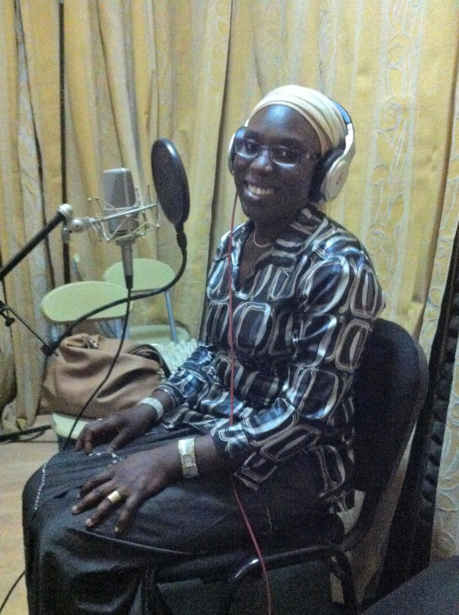 Khadidiatou Mbengue recording the content for IVR training