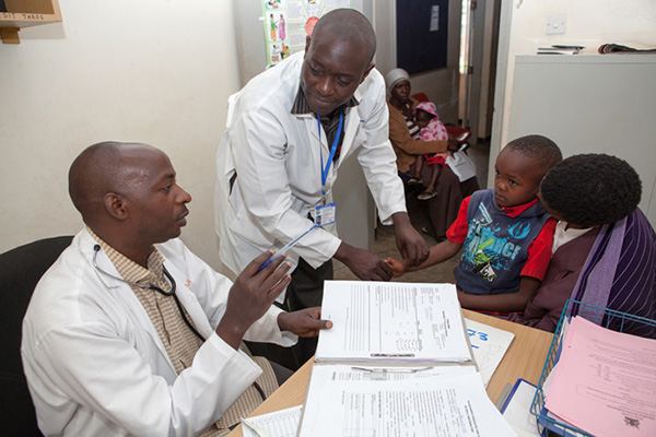 Health workers and clients in Uganda